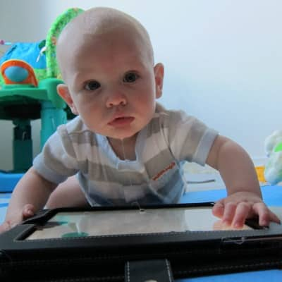 image of a baby drooling on an iPad (clearly using screen time rules that work)