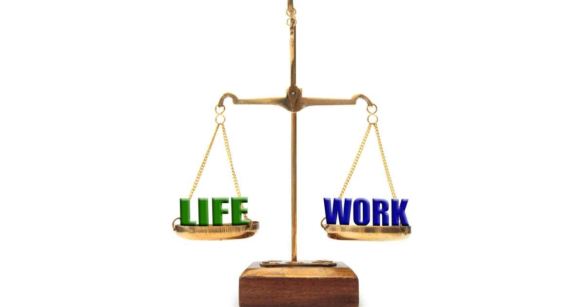 illustration of a balance scale with LIFE on one side and WORK on the other