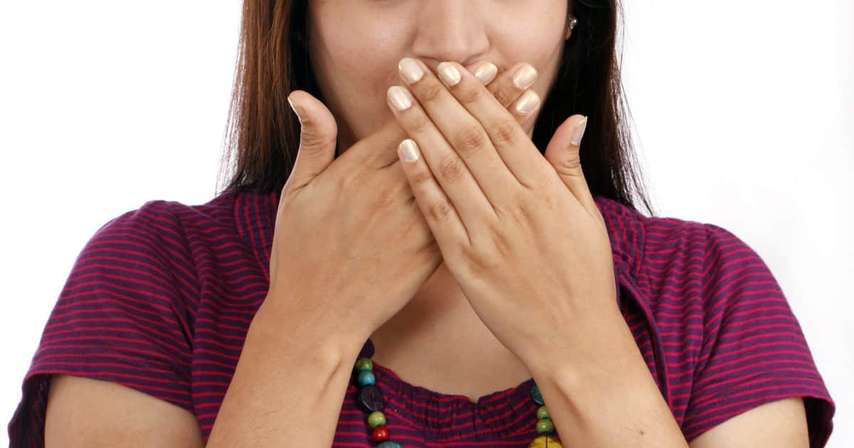 how to stop cursing around my kids - image of a woman covering her mouth