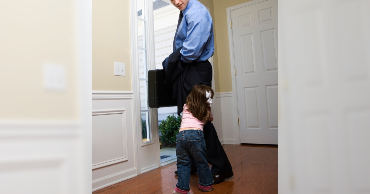 young daughter clinging to her father's leg as he tries to leave for work