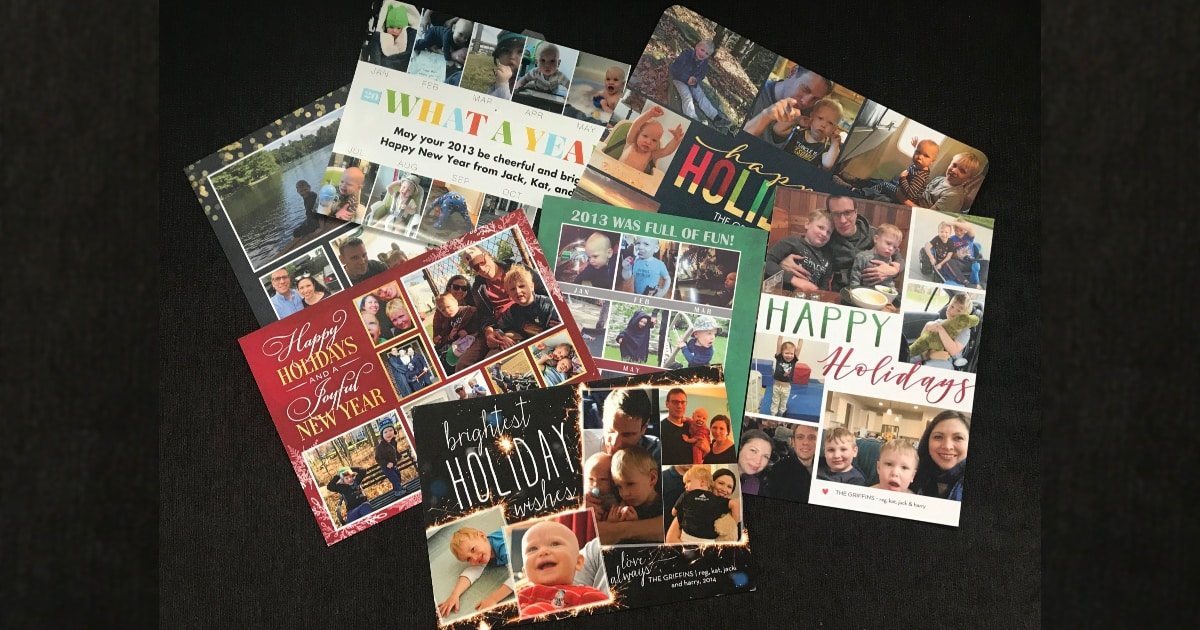a messy pile of Kat's family holiday cards from Shutterfly over the past 8 years