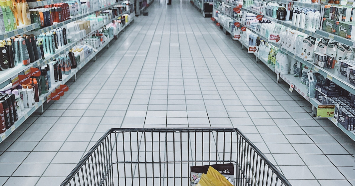 first person POV of grocery cart being pushed down store aisle