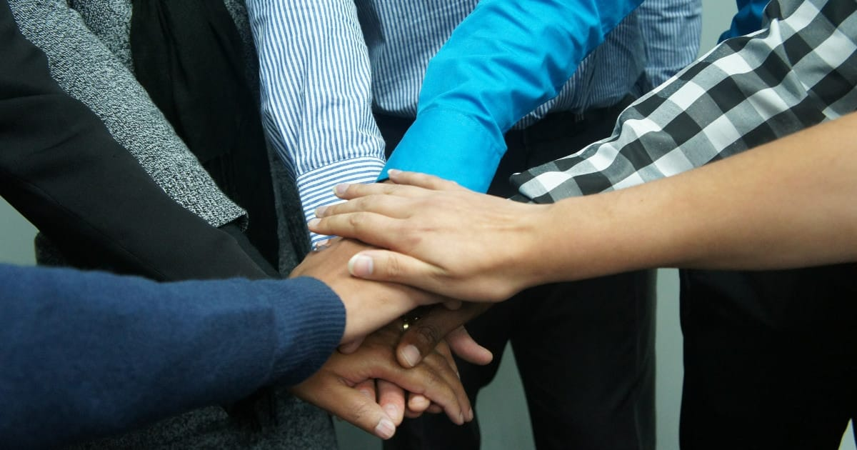 working parents group tips and advice - image of team hands